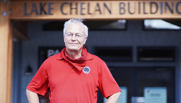 male Lake Chelan Building Supply staff member standing outside of Chelan store