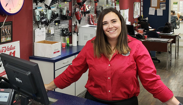 female Lake Chelan Building Supply staff standing at checkout counter