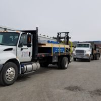 loaded lake chelan building supply delivery trucks
